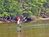 Indian Summer fly fishing Margaree River at Cape Breton Island, Nova Scotia, Canada
